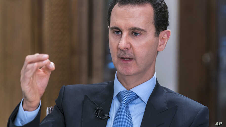FILE - In this photo released June 13, 2018, by the Syrian official news agency SANA, Syrian President Bashar al-Assad speaks during an interview with Iran's Al Alam TV, in Damascus, Syria.