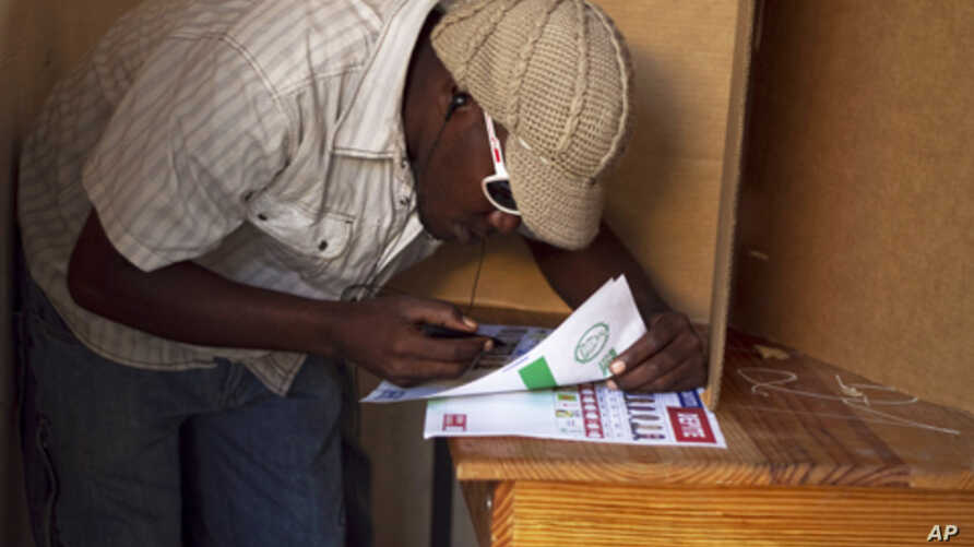 A man prepares to cast his vote at a voting station in Croix des Bouquets just outside of Port au Prince, 28 Nov 2010