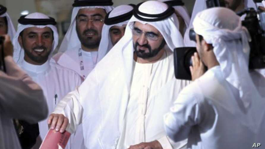 Sheikh Mohammed bin Rashid Al Maktoum (C), vice president of the UAE and ruler of Dubai, casts his vote at a polling station during the Federal National Council elections in Dubai, September 24, 2011.