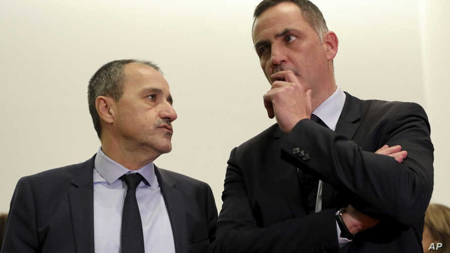 President of the Corsican assembly Gilles Simeoni (R) and French independentist Jean-Guy Talamoni talk during a meeting with French President Emmanuel Macron, Feb. 6, 2018 in Ajaccio, Corsica.