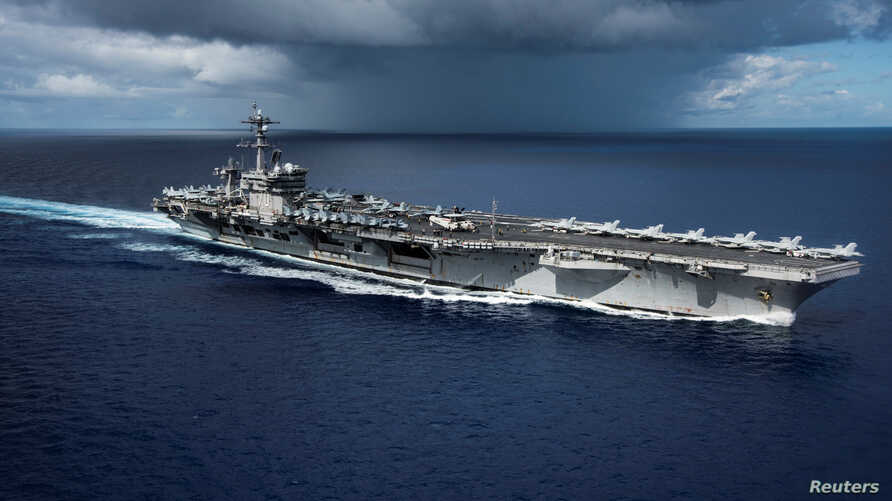 The Nimitz-class U.S. Navy aircraft carrier USS Carl Vinson transits the Philippine Sea