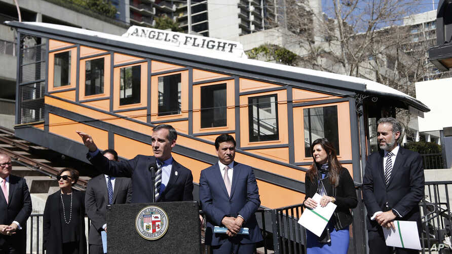 Los Angeles Mayor Eric Garcetti speaks at news conference standing in front of the Angels Flight railway in Los Angeles, California, March 1, 2017.