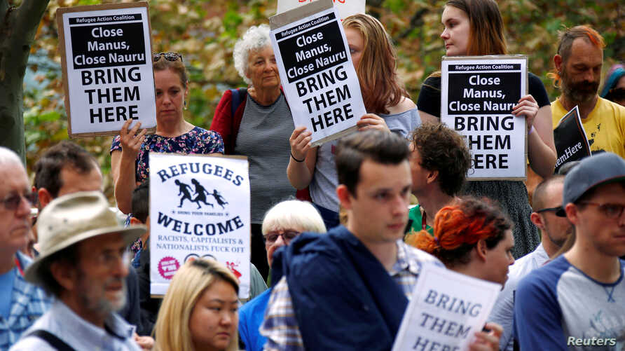 FILE - Protesters from the Refugee Action Coalition hold placards during a demonstration outside the offices of the Australian Government Department of Immigration and Border Protection in Sydney, Australia, April 29, 2016.