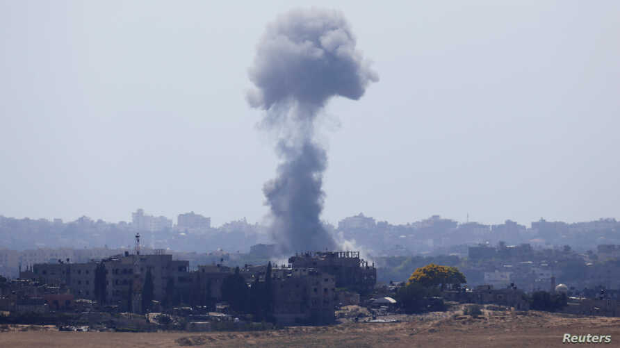 Smoke rises after an explosion in the northern Gaza Strip July 15, 2014. Israeli air strikes resumed in the Gaza Strip on Tuesday, Reuters witnesses said, six hours after Israel unilaterally entered an Egyptian-proposed truce that was never accepted ...