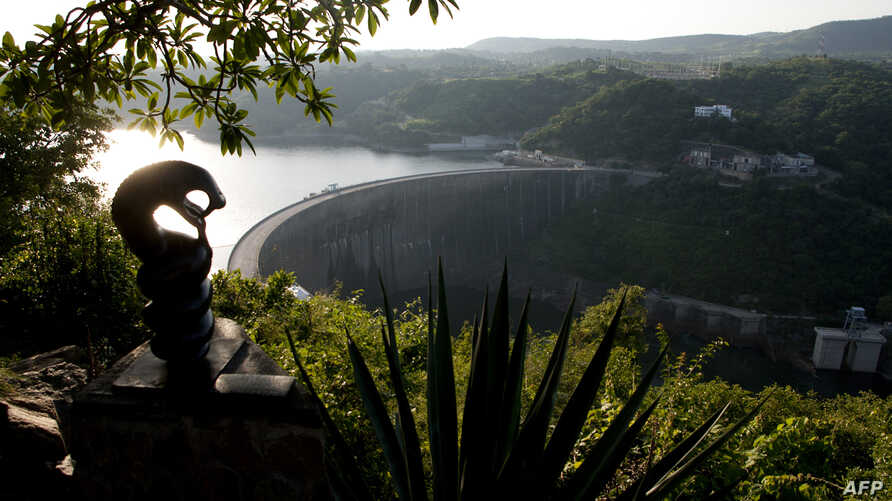 FILE - A general view of the the Kariba Dam wall between Zimbabwe and Zambia, Feb. 19, 2015, on the eve of the signing of $294 million in deals with international investors. The overhaul project will fix deformities and cracks in walls that were disc