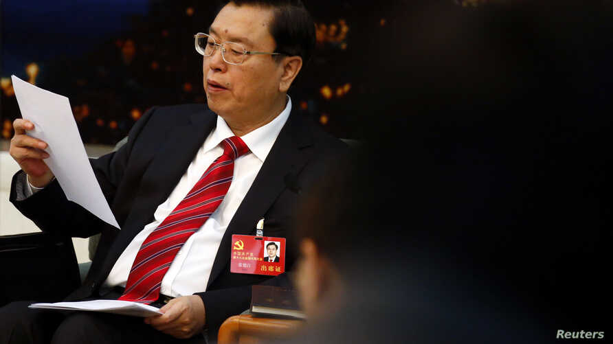 Zhang Dejiang reads his statement during a meeting held on the sidelines of the 18th National Congress of the Communist Party of China (CPC), at the Great Hall of the People in Beijing, November 8, 2012.