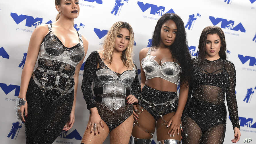 """Dinah Jane, from left, Ally Brooke, Normani Kordei, and Lauren Jauregui of Fifth Harmony, winners of the award for best pop video for """"Down,"""" pose in the press room at the MTV Video Music Awards."""