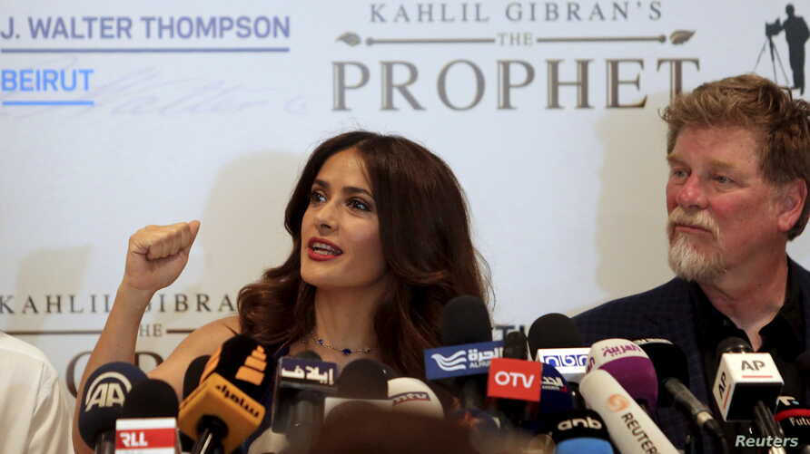 """Movie star Salma Hayek speaks during a news conference to promote her film """"The Prophet"""" as writer and director Roger Allers (R) looks on, in Beirut, Lebanon, April 27, 2015"""