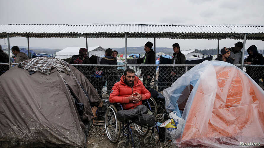 Syrian refugee Radwan Sheikho, 30, is seen among tents at a makeshift camp for refugees and migrants at the Greek-Macedonian border near the village of Idomeni, Greece, March 16, 2016.