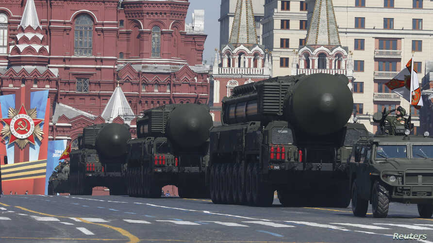 Russian mobile Topol-M missile launching units drive in formation during the Victory Day parade in Moscow's Red Square May 9, 2014. Russia celebrates the 1945 victory over Nazi Germany during World War II on May 9.