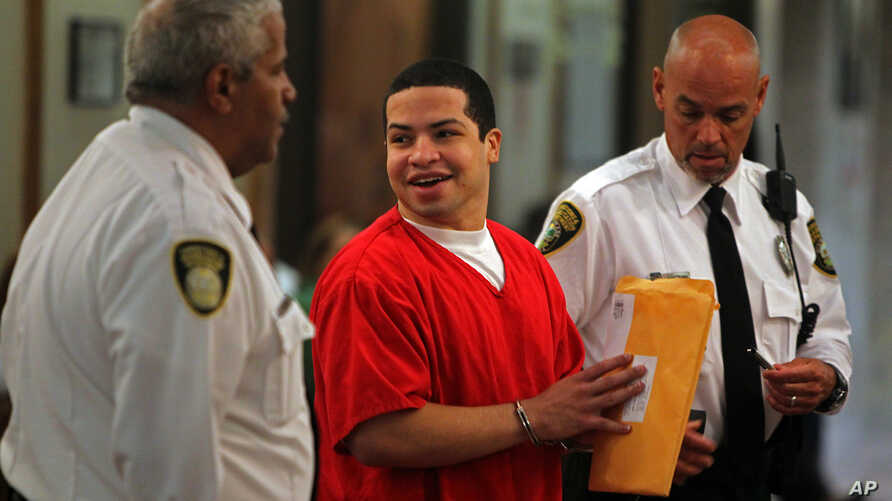 Eric Rivera, Jr. is moved to the courtroom holding room for the start of the fourth day of jury deliberation - and later found guilty - in the murder trial of Washington Redskins football star Sean Taylor, in Miami, Nov. 4, 2013.