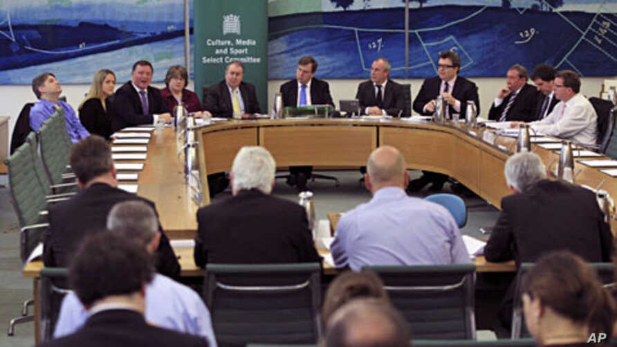 British members of Parliament face the media during the Department of Culture Media and Sport press conference announcing a cross-party report on phone hacking in London, May 1, 2012.
