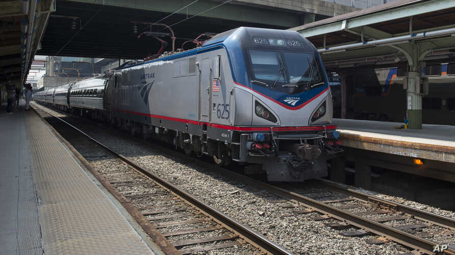 FILE - An Amtrak train departs Union Station in Washington, Sept. 3, 2015.
