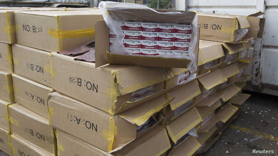 FILE - Cartons of counterfeit cigarettes are seen before being destroyed in Durban, June 24, 2011.