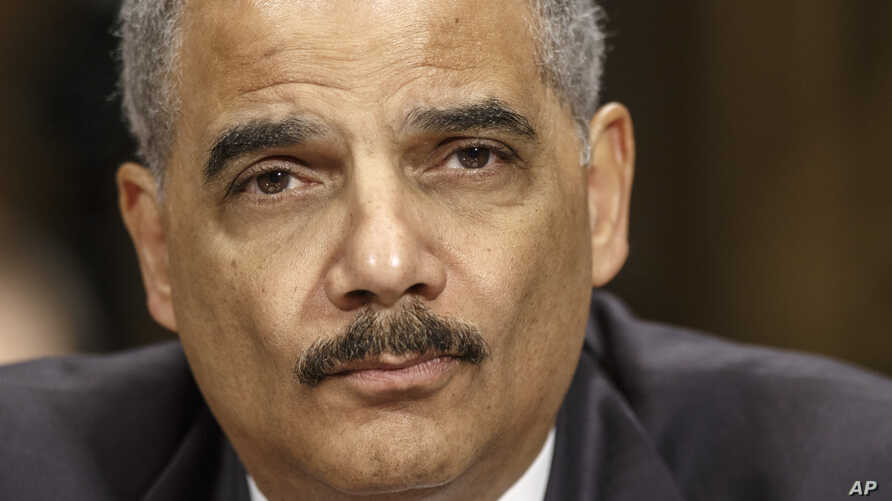 FILE - Attorney General Eric Holder testifies on Capitol Hill in Washington before the Senate Judiciary Committee hearing oversight hearing on the Justice Department.