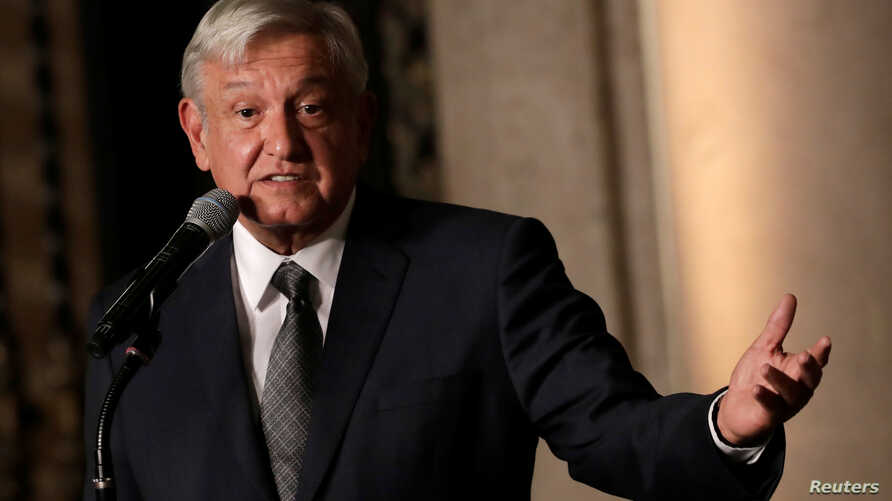 Mexico's incoming president Andres Manuel Lopez Obrador speaks to the media after a meeting with President Enrique Pena Nieto at National Palace in Mexico City, Aug. 9, 2018.