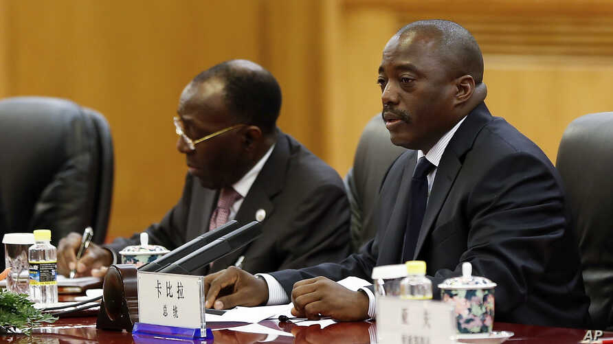 Democratic Republic of Congo President Joseph Kabila, right, attends a meeting with Chinese President Xi Jinping at the Great Hall of the People in Beijing, Sept. 4, 2015.
