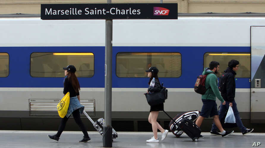 People walk on a platform to take a train, at the Saint-Charles railway station, in Marseille, southern France, June, 1, 2016.