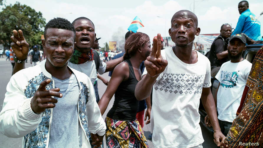 Congolese opposition activists gesture during a march to press President Joseph Kabila to step down in the Democratic Republic of Congo's capital Kinshasa, September 19, 2016.