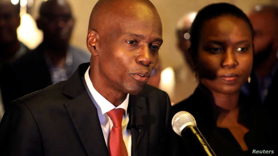 Jovenel Moise addresses the media next to his wife Martine after winning 55.67 percent of the vote in the November 20 presidential election, according to the electoral council, in Port-au-Prince, Haiti, Nov. 28, 2016.