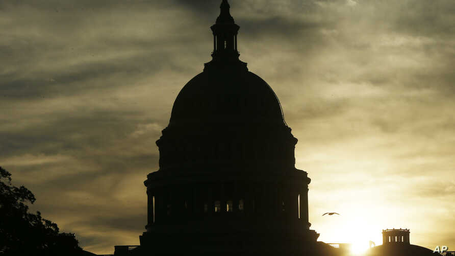 The sun rises over the U.S. Capitol in Washington, Sept. 24, 2013.