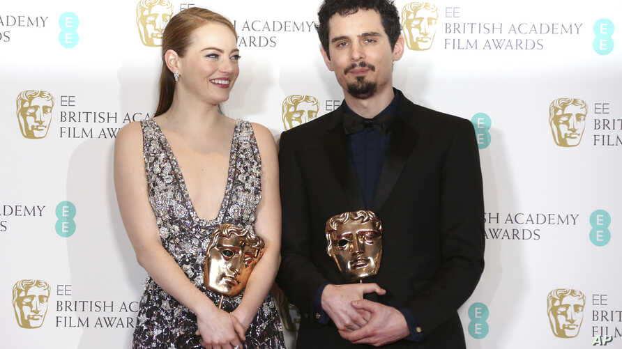 "Actress Emma Stone with her BAFTA award for Best Actress and director Damien Chazelle with his BAFTA award for Best Director both for the film ""La La Land' pose backstage at the British Academy Film Awards in London, Sunday, Feb. 12, 2017."