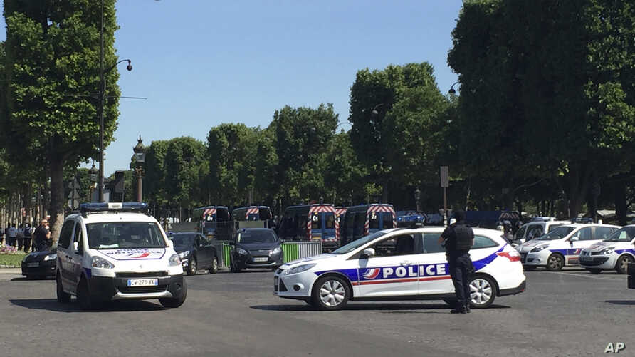 Police vehicles prevent the access to the Champs Elysees avenue in Paris, France, June 19, 2017. Paris officials say : Suspected attacker 'downed' after driving into police car on Champs-Elysees.