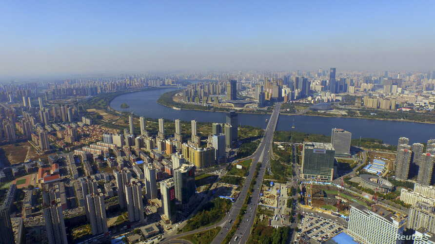 FILE - An aerial view shows the city skyline of Shenyang, Liaoning province, China, Oct. 18, 2015.