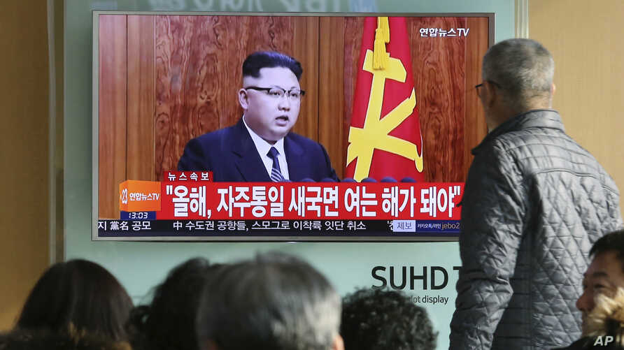 "South Koreans watch North Korean leader Kim Jong Un's New Year's speech on TV, at the Seoul Railway Station in Seoul, South Korea, Jan. 1, 2017. Kim said North Korea's development of long-range missiles is in ""final stages."""