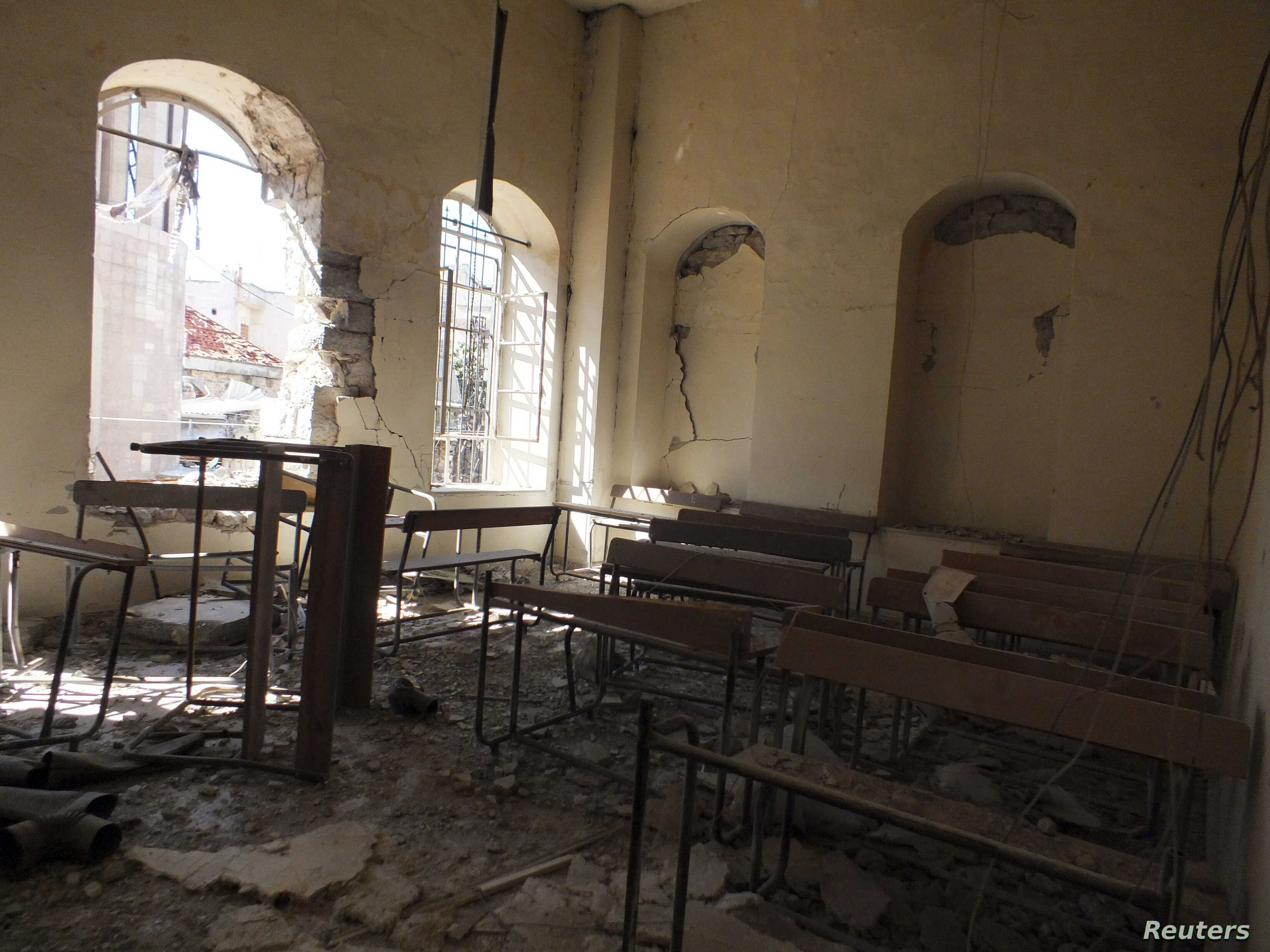 The interior of a damaged school is pictured in the old city of Homs, Syria, March 2, 2013.