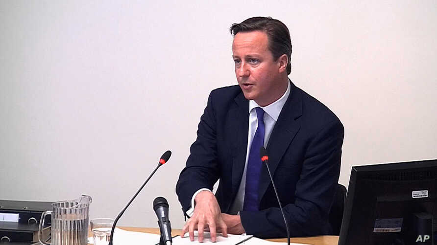 In this image from video, Britain's Prime Minister David Cameron testifies at the Leveson Inquiry, an official media ethics inquiry, in London, June 14, 2012.