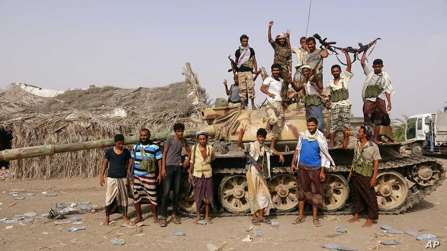 Tribal fighters loyal to the Yemeni government stand by a tank in al-Faza area near Hodeida, Yemen June 1, 2018.