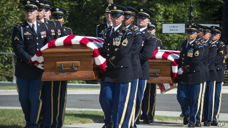 FILE - In this Sept. 6, 2018, photo, the 3rd Infantry Regiment, also known as the Old Guard, carries the remains of two unknown Civil War Union soldiers to their graves at Arlington National Cemetery in Arlington, Va. The U.S. Army is being criticize