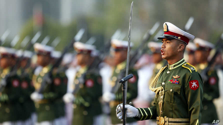 Myanmar soldiers parade during a ceremony to mark the 69th anniversary of Union Day in Naypyitaw, Myanmar, Feb. 12, 2016.