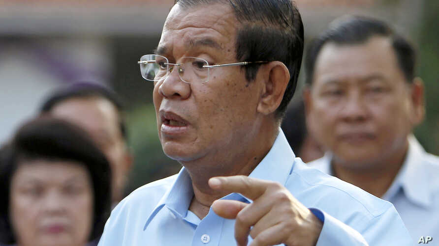 FILE - Cambodian Prime Minister Hun Sen speaks after his voting in a senate election at Takhmau polling station in Kandal province, southeast of Phnom Penh,  Feb. 25, 2018.