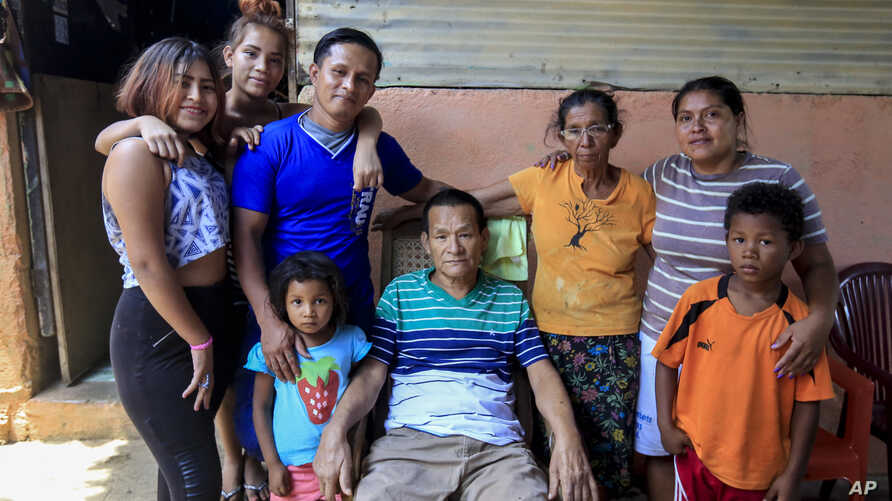 Franklin Perez, 29, wearing a solid blue jersey, poses with his family in their home, after he was released to house arrest, in Managua, Nicaragua, April 5, 2019. Perez is among the 50 people released Friday who had been jailed for protesting against