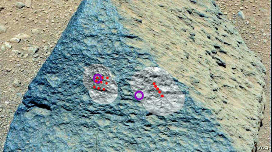 """This image shows where NASA's Curiosity rover aimed two different instruments to study a rock known as """"Jake Matijevic."""" (NASA/JPL-Caltech/MSSS)"""