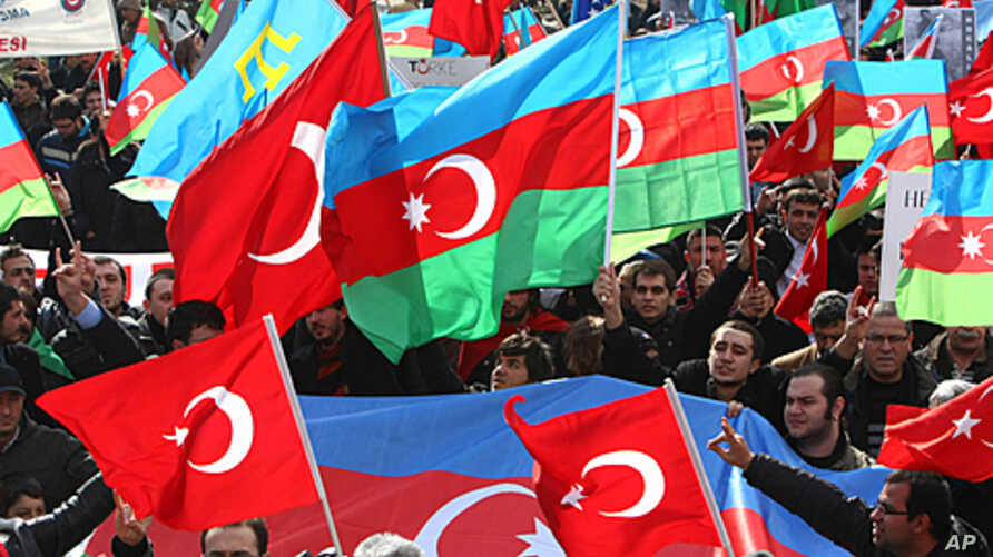 People wave Turkish and Azerbaijan flags as they gather in Ankara on  to commemorate the 20th anniversary of one of the bloodiest incidents of Azerbaijan's war with Armenia over disputed Nagorny Karabakh, FILE February 26, 2012.