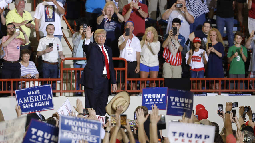 President Donald Trump waves as he leaves a rally in Harrisburg, Pa., April 29, 2017.