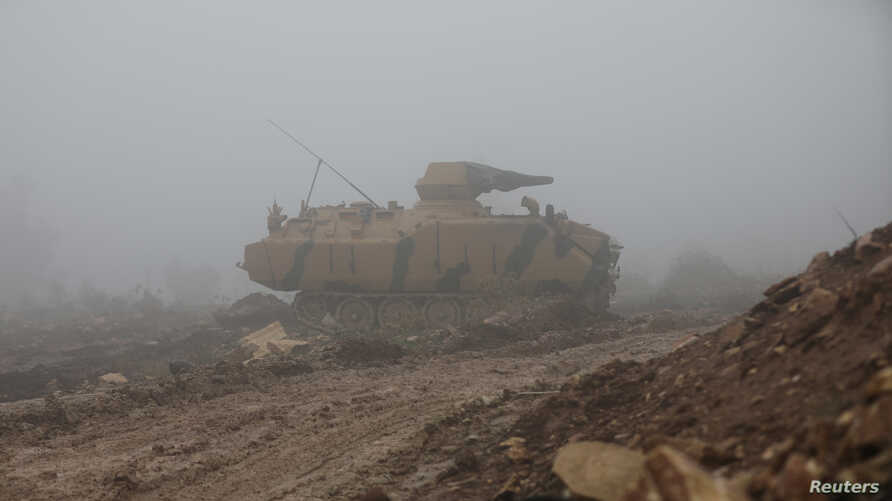 A Turkish military tank is seen near Mount Barsaya, northeast of Afrin, Syria, Jan. 23, 2018. Five Turkish soldiers died Saturday in the Afrin area when their tank was attacked.