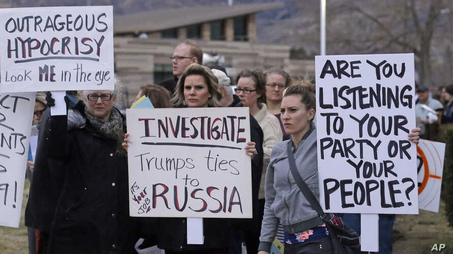 """People gather outside the Brighton High School before Rep. Jason Chaffetz's town hall meeting in Cottonwood Heights, Utah, Feb. 9, 2017. In an echo of the raucous complaints that confronted Democrats back in 2009 as they worked to pass """"Obamacare"""" in"""