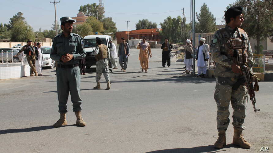 Security forces guard near Abdul Jabar Qahraman's house, a parliamentary election candidate, after he was killed in an explosion inside his home in Lashkar Gah, Afghanistan, Wednesday, Oct. 17, 2018.