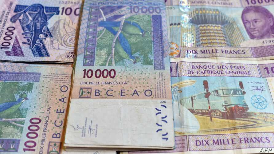FILE - CFA franc banknotes by the Central Bank of West African States are seen in N'djamena, Chad, April 9, 2016. Some experts argue that the colonial era currency has outlived its usefulness.