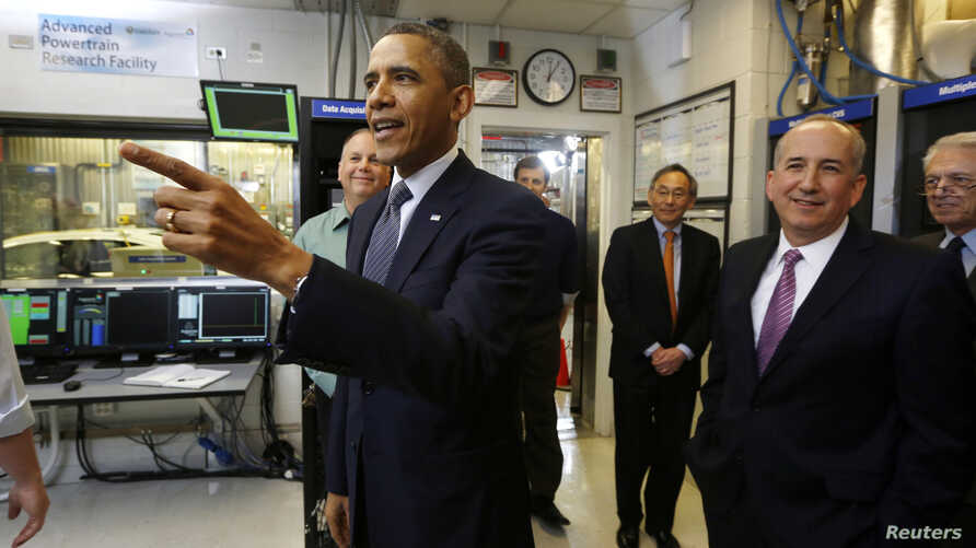 U.S. President Barack Obama tours the Argonne National Lab near Chicago, March 15, 2013. Obama traveled to Chicago on Friday for an event where he will propose diverting $2 billion in revenue from federal oil and gas leases to pay for research on adv
