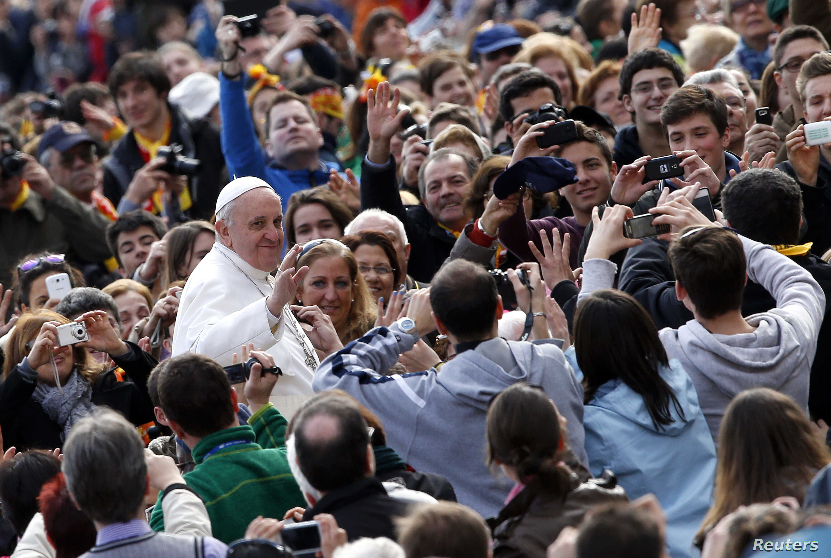Pope Francis waves as he arrives to lead a weekly general audience in Saint Peter's Basilica, at the Vatican, Apr. 3, 2013.