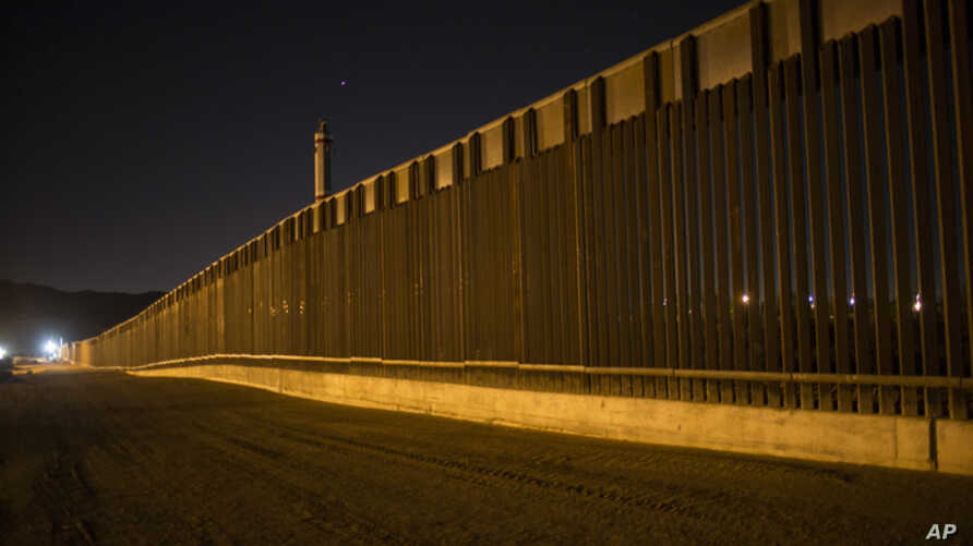 A portion of the new steel border fence stretches along the US-Mexico border in Sunland Park, New Mexico, March 30, 2017. This fencing just west of the New Mexico state line was planned and started before President Donald Trump's election.