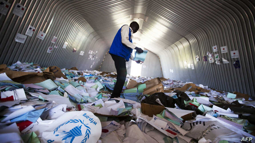 A staff member of the World Food Program (WFP) examines on Aug. 18, 2016 the remains of the logistic base of the United Nations (UN) organization in the Jebel district in Juba, after it was looted during clashes between Government and opposition forc