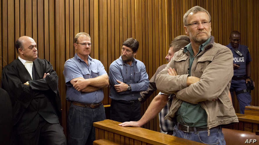Some of the 20 right-wing extremists convicted of high treason for a plot to kill former South African president Nelson Mandela and drive blacks out of the country attend their trial at Pretoria High Court on Oct. 29, 2013.