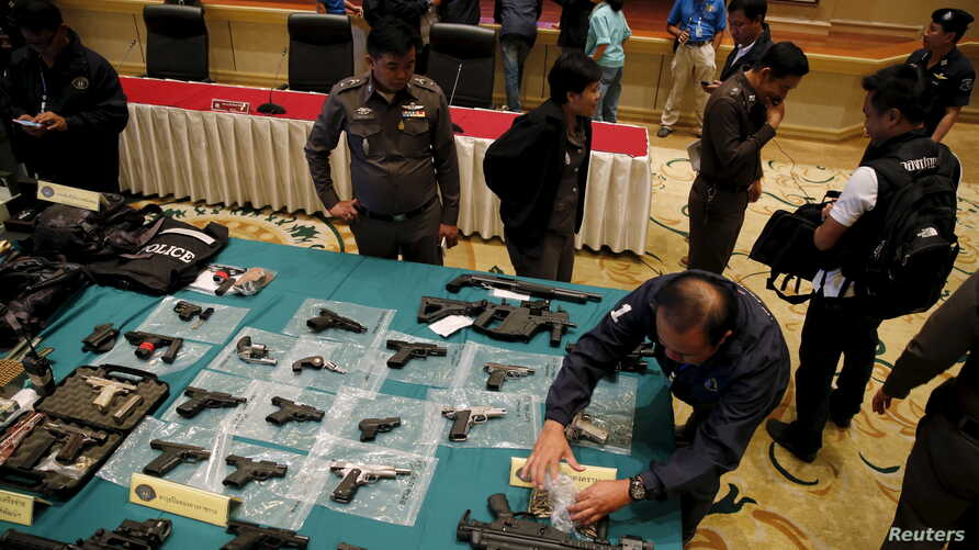 Confiscated weapons are displayed on a table during a news conference at Royal Thai Police headquarters in Bangkok, Oct. 28, 2015.