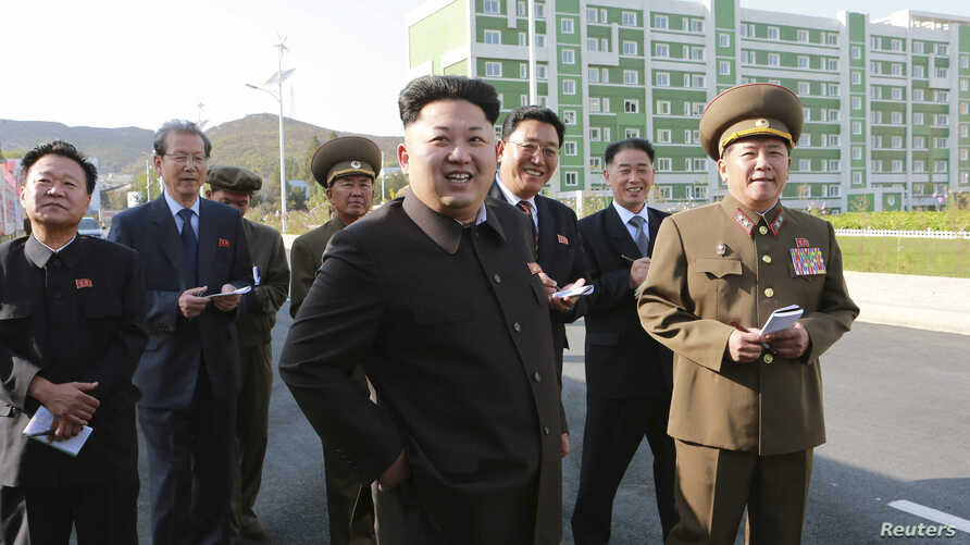 North Korean leader Kim Jong Un gives field guidance at the newly built Wisong Scientists Residential District in this undated photo released by North Korea's Korean Central News Agency (KCNA) in Pyongyang October 14, 2014. Kim, shown using a cane fo
